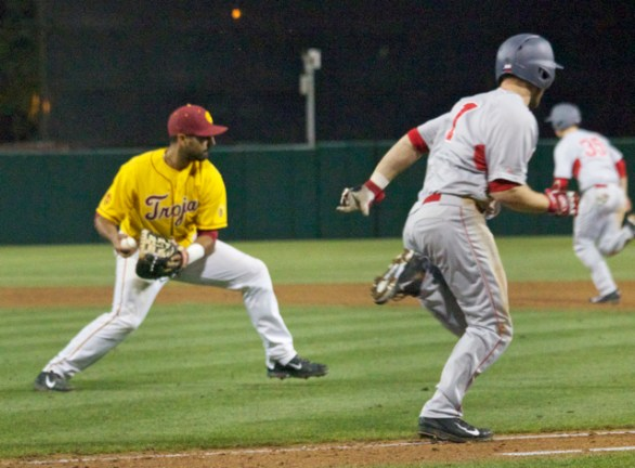 Jake Hernandez turns to throw to first on a bunt.