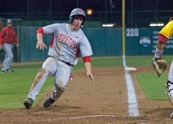 Caleb Barker slides in with a run. (Photo: Shotgun Spratling)