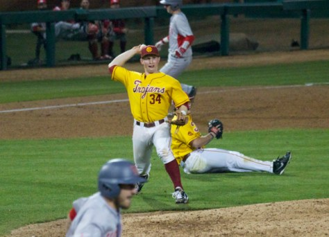 Kevin Swick makes the play on a bunt.