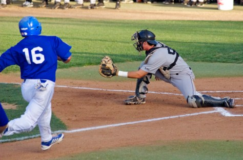 Eric Hutting grabs the throw from the outfield. (Photo: Shotgun Spratling)