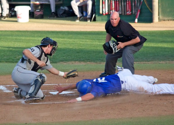 Cody Hough tries to avoid the tag at the plate. (Photo: Shotgun Spratling)