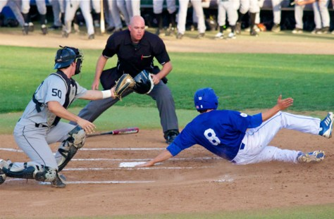Joe Chavez tags home as he slides in and is called safe. (Photo: Shotgun Spratling)