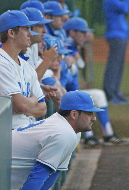 The UCLA dugout watches on, facing another jam. (Photo: Shotgun Spratling)