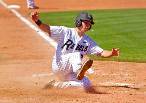 Justin Jones slides in with the tying run. (Photo: Shotgun Spratling)