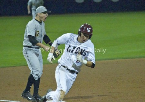 David Head screams as Austin Miller rounds third.