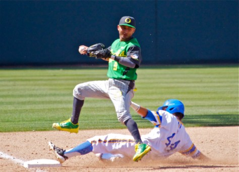 Kevin Minjares tries to jump out of the way of Brett Urabe's slide. (Photo: Shotgun Spratling)