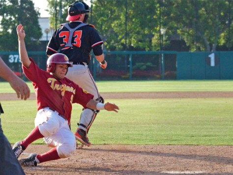 Frankie Rios comes across with the go-ahead run. (Photo: Shotgun Spratling)