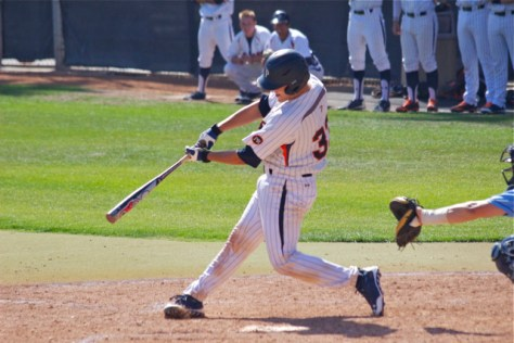 Aaron Barnett delivers an RBI single. (Photo: Shotgun Spratling)