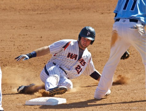 Aaron Brown slides into 3B. (Photo: Shotgun Spratling)
