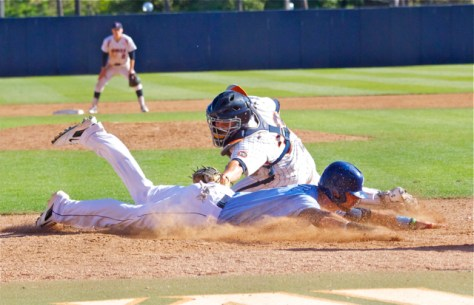 Louie Lechich dives in with the go-ahead run. (Photo: Shotgun Spratling)