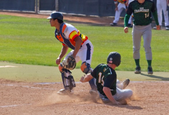 Michael Eaton slides in with a run. (Photo: Shotgun Spratling)