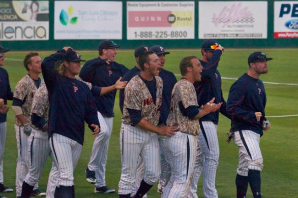 The Pepperdine dugout waits to congratulate Hutton Moyer. (Photo: Shotgun Spratling)