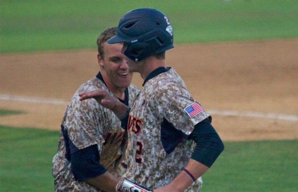 Aaron Barnett congratulates Hutton Moyer. (Photo: Shotgun Spratling)