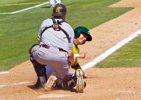 Will Soto's slide spiked Brian Serven in the leg, forcing him to leave the game. (Photo: Shotgun Spratling)