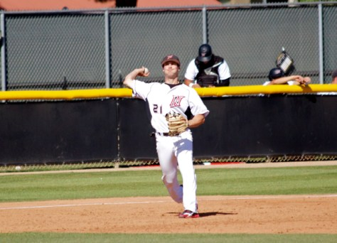 Michael Livingston throws to first.