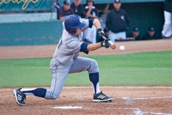 Grant Palmer lays down the bunt. (Photo: Shotgun Spratling)