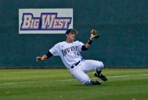 Kris Paulino makes a sliding catch. (Photo: Shotgun Spratling)