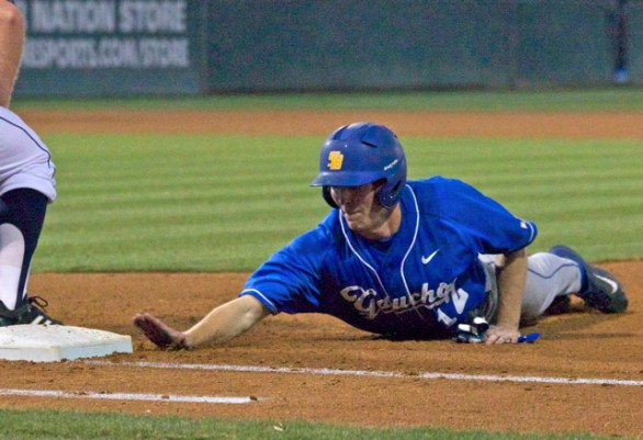 Cameron Newell dives back to first. (Photo: Shotgun Spratling)