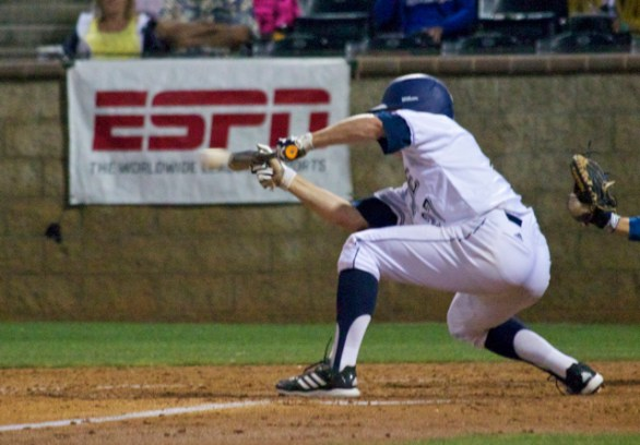 Chris Rabago lays down the sac bunt. (Photo: Shotgun Spratling)
