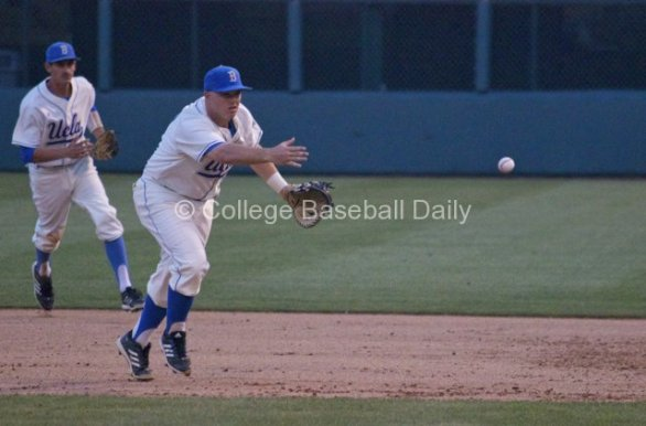 Pat Gallagher flips to first base.