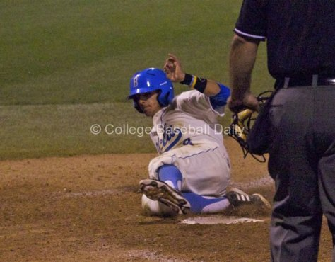 Trent Chatterton slides home with a run.