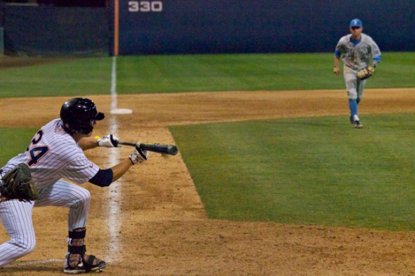 Greg Velazquez puts down a textbook bunt. (Photo: Shotgun Spratling)