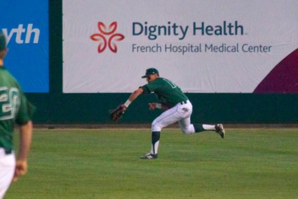 Nick Torres makes a running back-handed catch in the gap. (Photo: Shotgun Spratling)