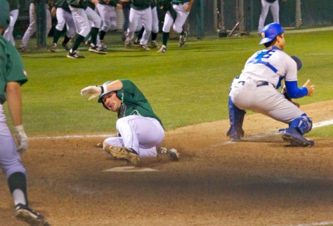 Brett Barbier slides in with the winning run. (Photo: Shotgun Spratling)