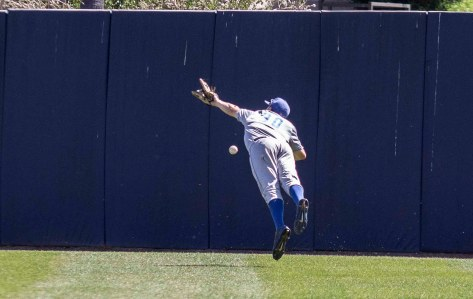Scott Quinlan can't make a lunging catch. (Photo: Mark Alexander)