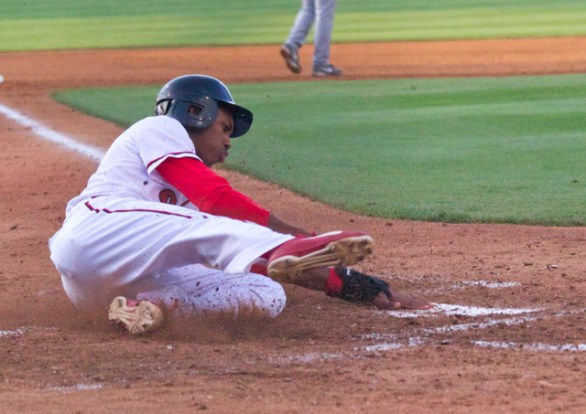 Greg Allen slides in with a run. (Photo: Shotgun Spratling)