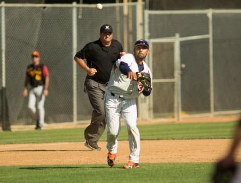 Austin Davidson throws across the diamond. Dante Flores fires to first. (Photo: Mark Alexander)