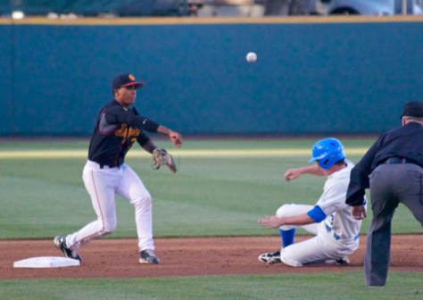 Dante Flores turns a double play. (Photo: Shotgun Spratling)