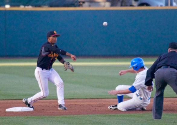 Dante Flores turns a double play. (Photo: Shotgun Spratling)