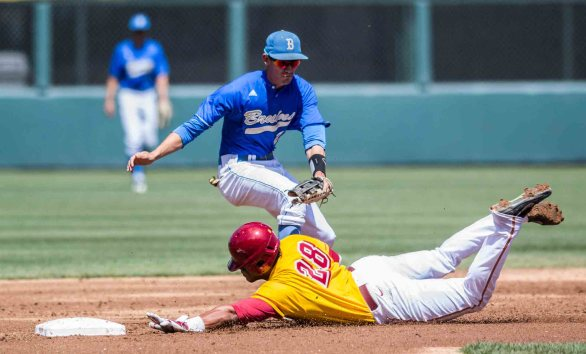 Timmy Robinson avoids the tag as he dives into 2B. (Photo: Mark Alexander)