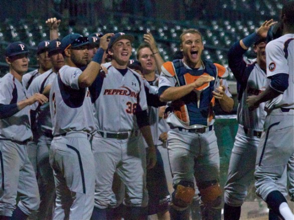 A happy Waves dugout greets Jefferson. (Photo: Shotgun Spratling)