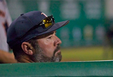 Steve Rodriguez peers out of the dugout. (Photo: Shotgun Spratling)