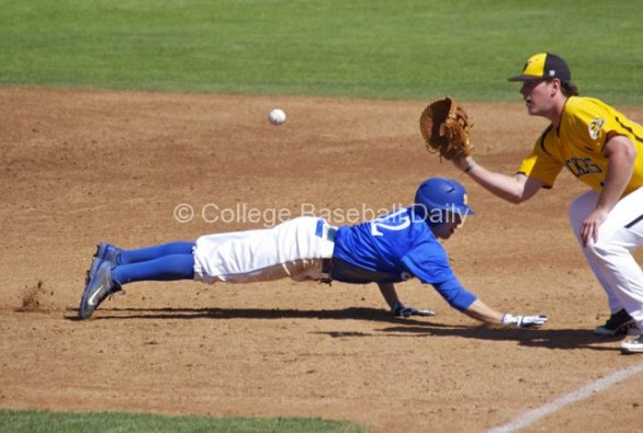 Cameron Newell dives back to first base.