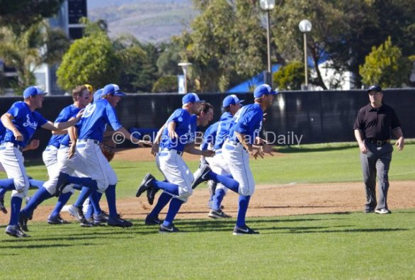 The UC Santa Barbara dugout explodes onto the field.
