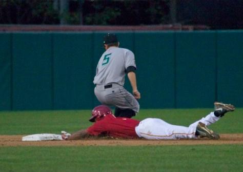 Dante Flores dives into second base.