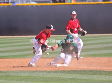Jordy Hart slides in safely as Ryan Raslowsky can't handle the throw.