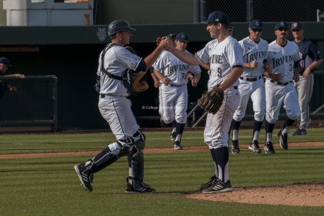 UCI Catcher Jerry McClanahan congratulates Sam Moore after getting the save