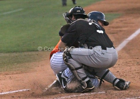 J.D. Davis slides into Eric Hutting's tag.