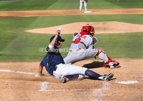 Matt Orloff slides in safely.