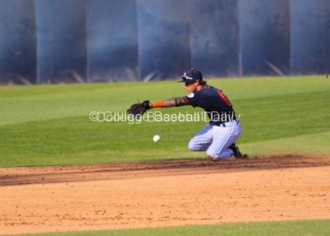 Richy Pedroza's sliding attempt can't stop the sharply hit ball.