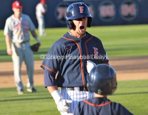 Anthony Hutting is pumped after his homer.