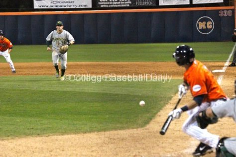 Ryon Healy charges as Keegan Dale lays down a bunt.