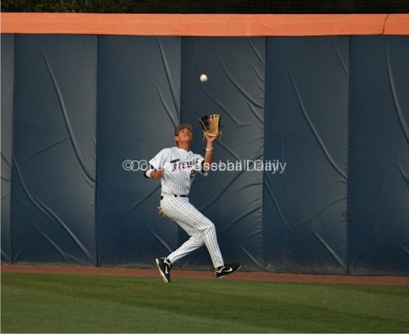 Greg Velasquez tracks down a ball near the wall