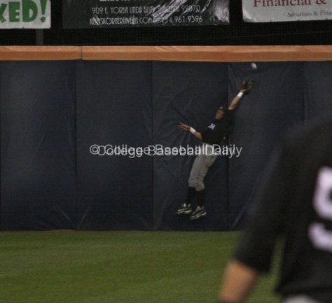 Johnny Bekakis can't make a catch at the wall.