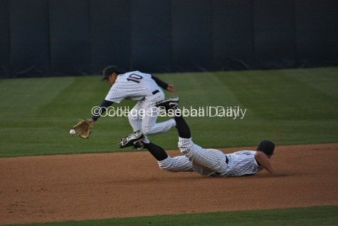 Matt Chapman and Anthony Trajano can't make a play in the hole.