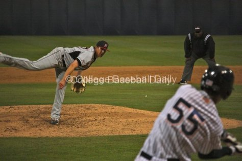 Vincent Roberts watches while Michael Lorenzen takes a hack.